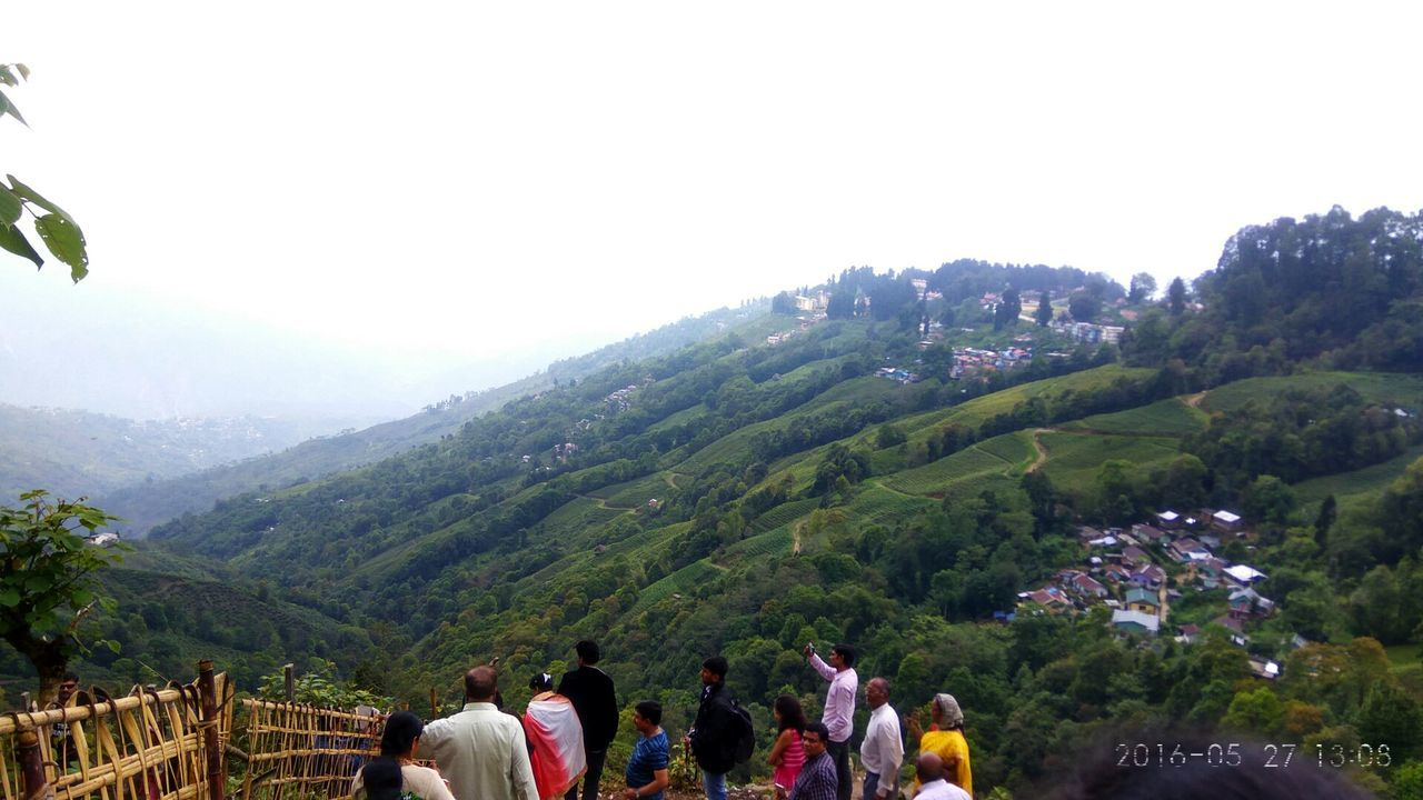 REAR VIEW OF TOURISTS ON MOUNTAIN