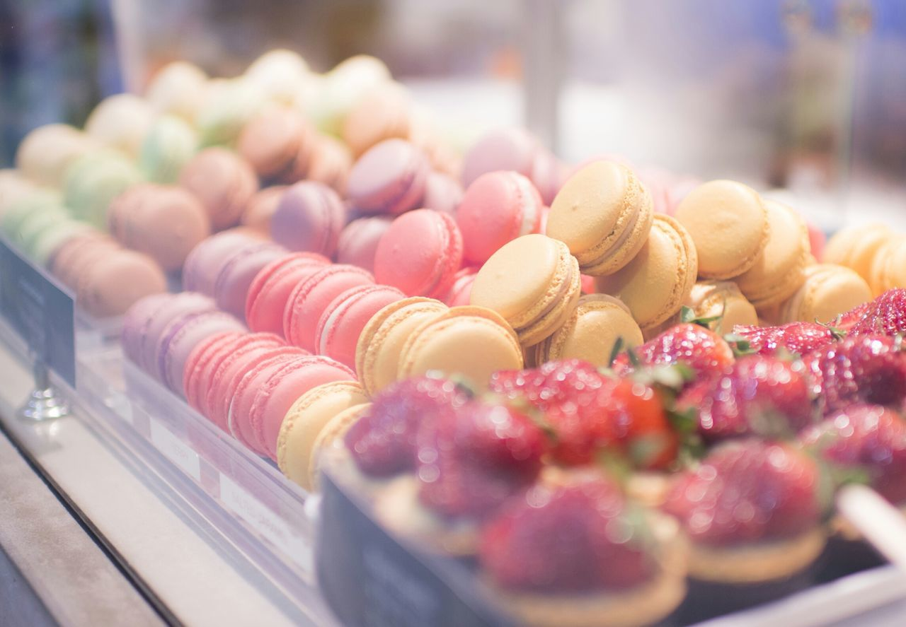 Macaroons in display cabinet at store