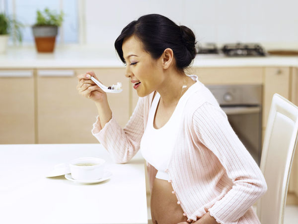 pregnant woman eating tonic 9 Months Expecting Growth Love Married Beautiful Woman Day Time Development Drink Fertile Fertility Food And Drink Holding Indoors  Kitchen Newlife One Person Pregnancy Pregnant Responsibility Sitting Taking Care Women