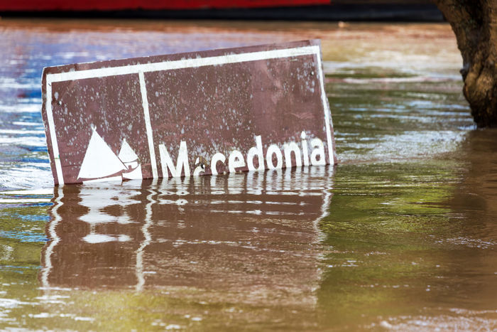 Sign to the indigenous community of Macedonia flooded by the Amazon River near Leticia, Colombia Amazon Amazon River Amazonas Amazonia Brown Colombia Day Flood Flooded Flooding Jungle Leticia Macedonia Nature No People Outdoors Puerto Nariño Rain Forest Rainforest Sign Tropical Water