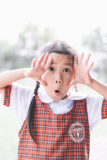 Close-up portrait of schoolgirl gesturing