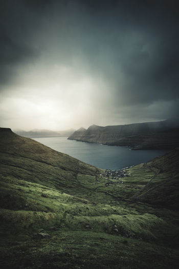 "Moody Funningur on the northwest coast of Eysturoy (""East Island""). Have you ever been to the Faroe Islands? What was your favorite place? For me it's hard to say.. the whole Islands were just spectacular! Location: Funningur, Faroe Islands Equipment: Fujifilm X-T2 + XF14 F2.8 R Atmosphere Beauty In Nature Day Europe Faroe Islands Funningur Färöer Globetrotter Grass Landscape Landscapes Moody Mountain Mountains Nature No People Outdoors Scenic Scenics Sea Sky Tranquil Scene Tranquility Wanderlust Water Lost In The Landscape"