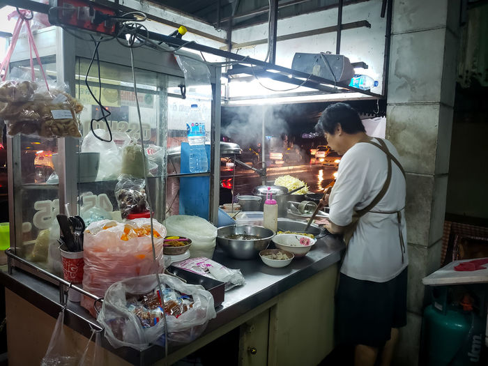 Merchants sell noodles Merchants Sell Selling Seller Noodles Noodle Soup At Night Night Country Life Lifestyle Photography Working Occupation Spraying Industry Business Men Metal Industry Business Finance And Industry Preparation  Manufacturing Equipment