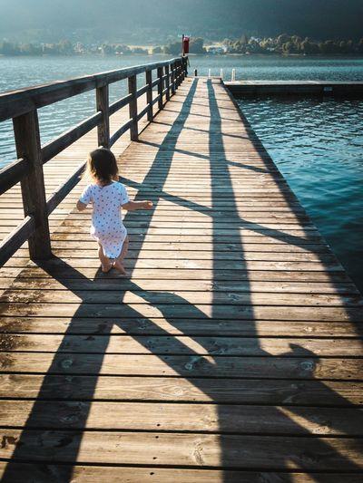 Full length of woman on wooden pier