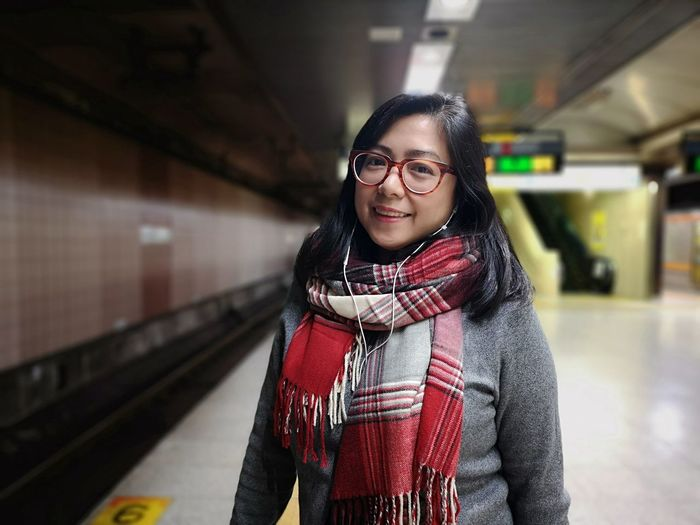 Subway To Work Woman Power Woman Japanese Culture Work Commute Commuter Commuter Train Professional The Modern Professional Subway Train Portrait Eyeglasses  City Subway Station Smiling Looking At Camera Station Standing Journey Subway Platform Subway Rail Transportation Public Transportation Underpass Railway Station Platform