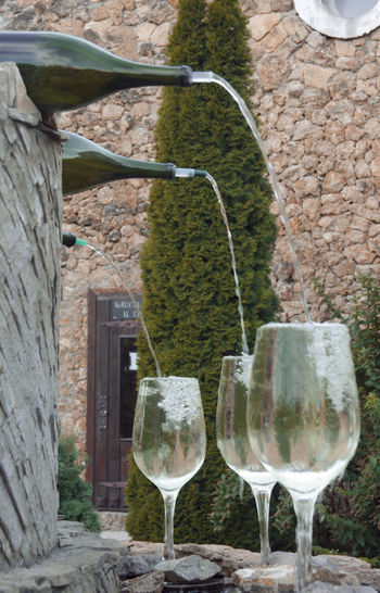 Wine glass against built structure