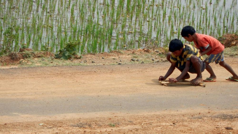 Village kids with a handmade skateboard... Two People Crouching Real People Boys Day Togetherness Outdoors Child Nikon L830 Coolpix The Street Photographer - 2017 EyeEm Awards Sport Playing
