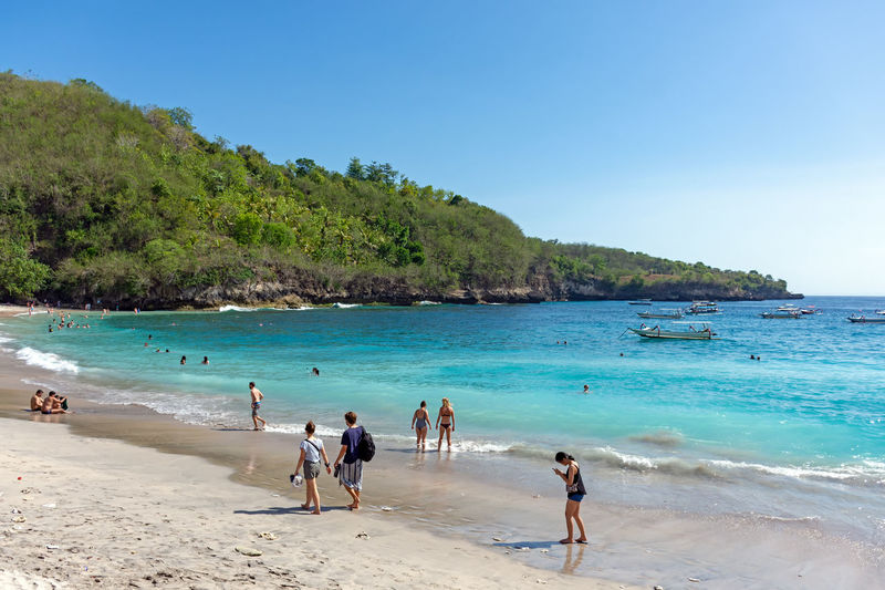 Nusa Penida Crystal Bay Land Water Beach Sea Group Of People Trip Vacations Sky Leisure Activity Holiday Sand Scenics - Nature Lifestyles Nature Men Beauty In Nature Day Enjoyment Crowd Outdoors Turquoise Colored Bali INDONESIA