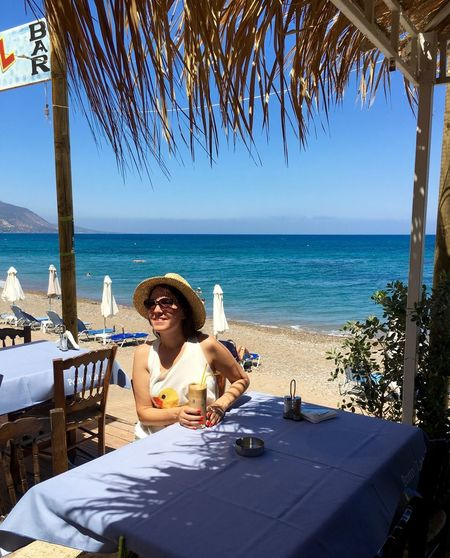 Cyprus Sitting Outside Summertime Beach Cafe Chair Coctail Horizon Over Water Leisure Activity Lifestyles One Person Outdoors Sea Sitting Summer Sun Hat Table Vacations Water Young Adult Young Women