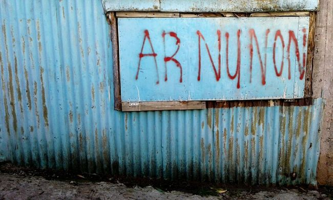 Ar Nu Non, Creole linguistic. Translation: Not To Us. Weathered Business Finance And Industry Day Communication No People Architecture Outdoors Built Structure Building Exterior Rotting Corrugated Iron Close-up Culture City Cultures