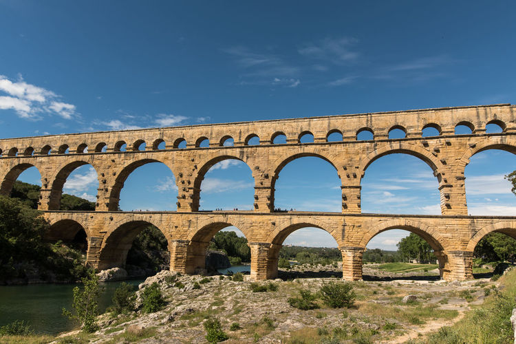 Ancient Ancient Civilization Aqueduct Arch Architecture Bridge - Man Made Structure Built Structure Cloud - Sky Day France History Low Angle View Nature No People Old Ruin Outdoors Pont Du Gard Provence Provence-Alpes-Cote D'Azur Sky Travel Travel Destinations