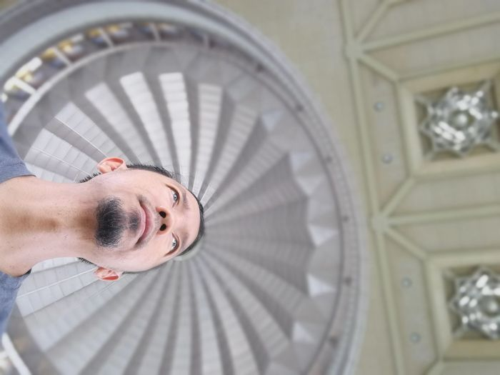 Low angle view of man against cupola