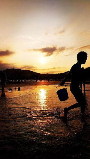 Sunset Sea Water Silhouette Kids Real People Beach China Backlight Shadow EyeEmNewHere Connected By Travel