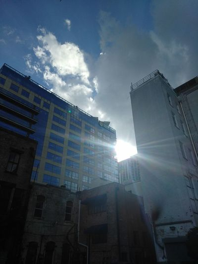 Sky Cloud - Sky Built Structure Architecture Building Exterior No People City Sunbeam Low Angle View Outdoors Skyscraper Day Buildings & Sky Sun Beaming City Life Building Reflection_collection Sun Behind Building Business District Downtown Orlando  Orlando Florida Sunshine Sunrays The City Light The Architect - 2017 EyeEm Awards The Street Photographer - 2017 EyeEm Awards The Architect - 2017 EyeEm Awards