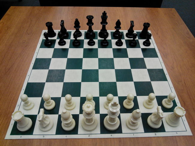 Chess Board Game Challenge Checked Pattern Chess Chess Board Chess Piece Competition Day High Angle View Indoors  Intelligence King - Chess Piece Knight - Chess Piece Leisure Games No People Pawn - Chess Piece Queen - Chess Piece Strategy Wood - Material