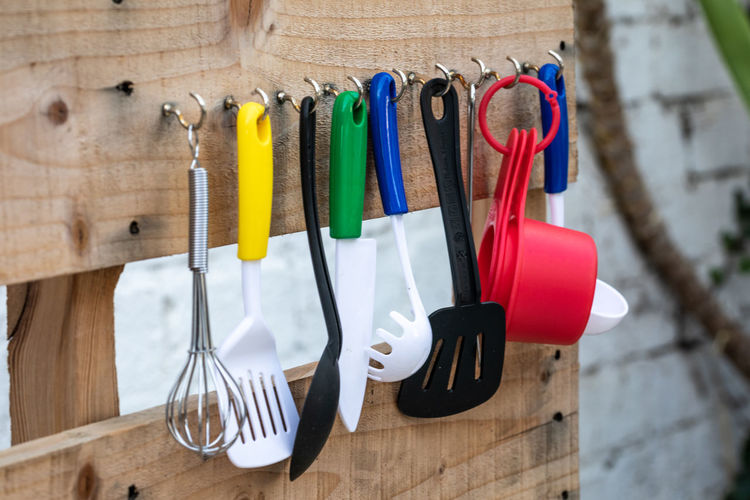 Close-up of utensils hanging on wall