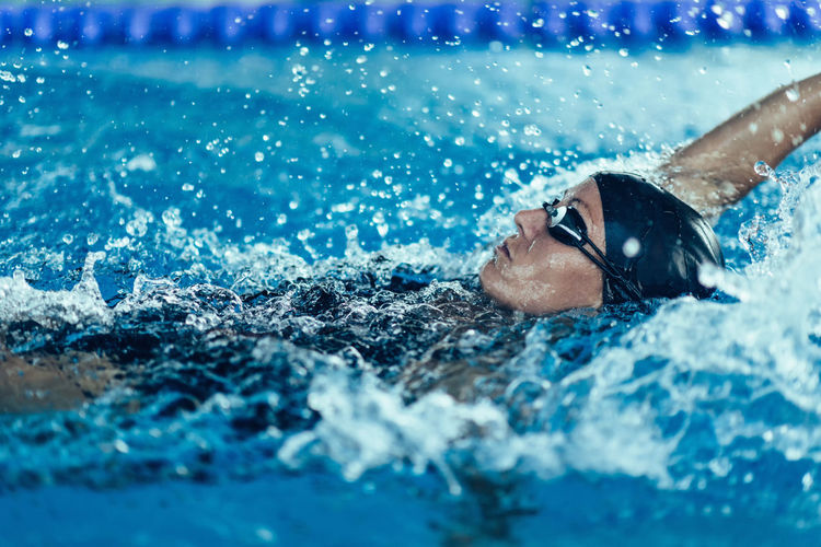 Woman swimming in pool during competition