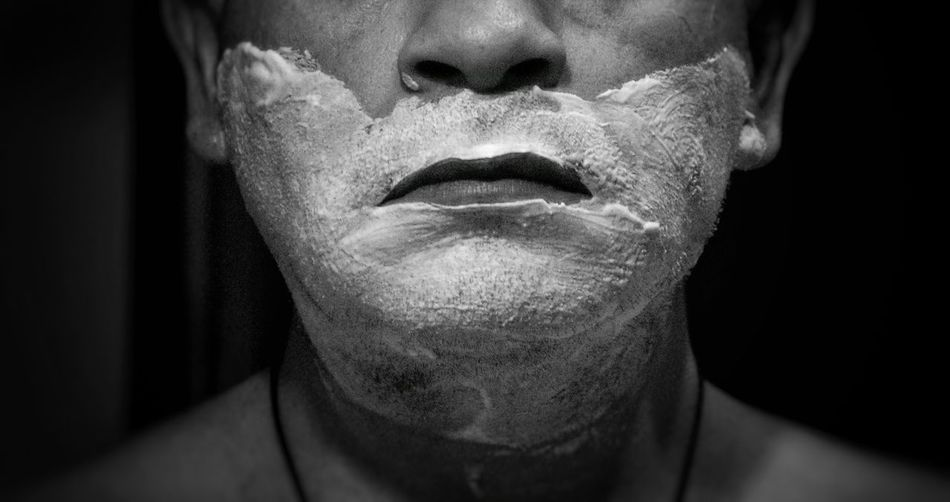 Midsection Of Man With Shaving Cream On Face