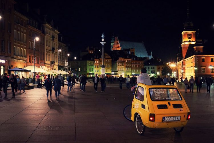 EyeEm Best Shots Palace Square Old Town Ecology Eco Taxi Stare Miasto Old Town Poland Warsaw City Night Architecture Building Exterior Street Built Structure Illuminated Real People Mode Of Transportation Transportation Large Group Of People City Life Car Group Of People Motor Vehicle Sky City Street Crowd Men Land Vehicle