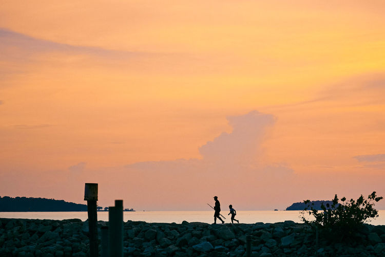 Sky Sunset Two People Men Silhouette Nature Real People Land Standing Leisure Activity Beauty In Nature Orange Color Lifestyles Togetherness People Scenics - Nature Water Outdoors Cloud - Sky Father And Son Go Fishing Healthy Lifestyle Anglers Weekend Activities Family