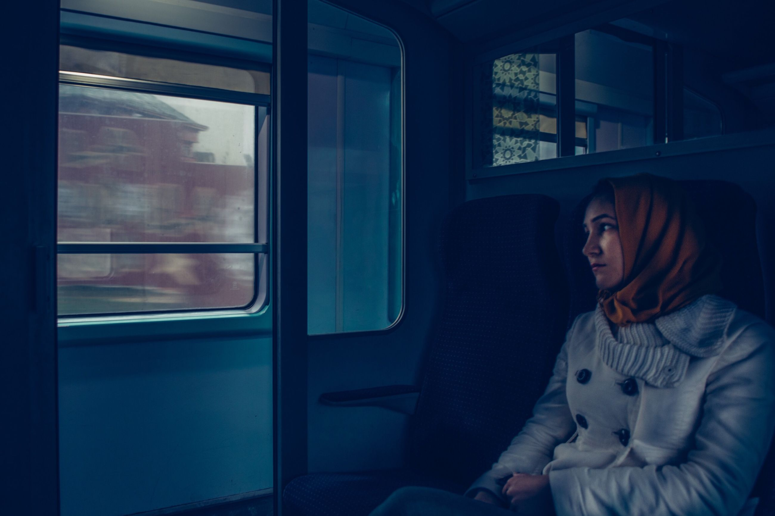 window, real people, transparent, train, mode of transportation, glass - material, rail transportation, train - vehicle, public transportation, transportation, travel, vehicle interior, women, one person, leisure activity, day, lifestyles, indoors, child