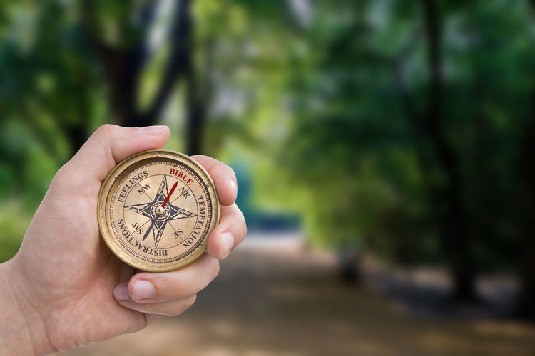Male Hand Holding Compass - Bible Male Hand Fingers Holding Compass Direction Christianity Religion Faith Navigation Lost Guidance Counsel Path Forest Trees Followme Wisdom Green Crossroads Route Way Preparation  Nature Inspire Bible
