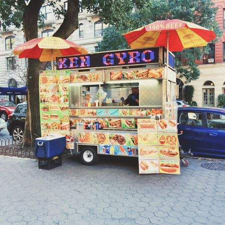 Hot dog fast food truck, New York City, United States of America. City Multi Colored Street Outdoors Transportation Day Mode Of Transport Building Exterior City Life Land Vehicle Architecture Variation Built Structure Real People Stationary Road Fast Food hot dogs Sausage