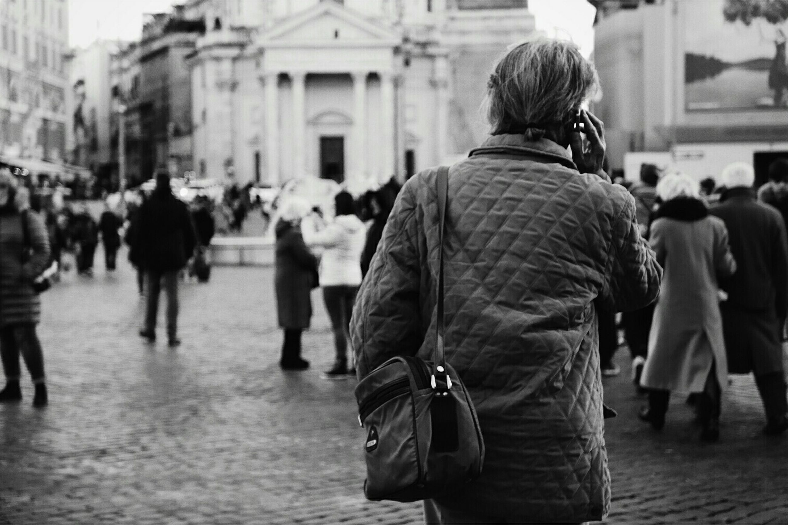 rear view, focus on foreground, real people, senior adult, walking, city, religion, women, men, outdoors, adults only, day, one person, adult, people