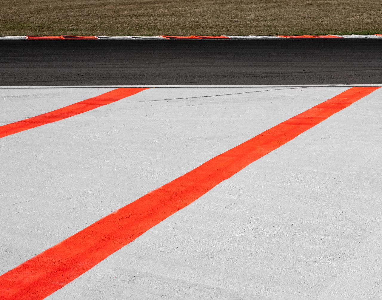 Red And White Marking On Sports Track