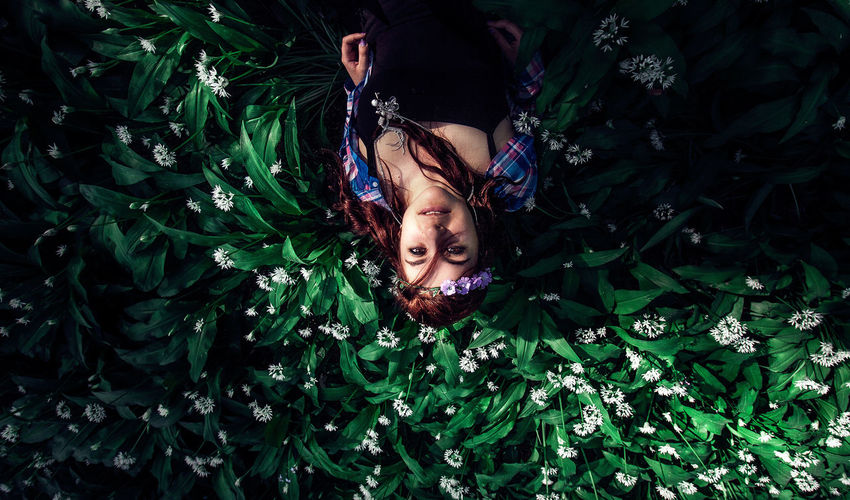 Portrait Of Woman Lying On Plants
