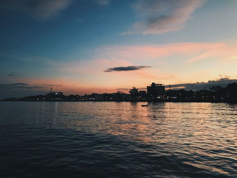 Sunsets are beautiful endings. Sunset Sky Water Architecture No People Sea Built Structure Cloud - Sky Silhouette Waterfront Building Exterior Outdoors Nature Beauty In Nature Scenics Tranquility City Nautical Vessel Cityscape Day The Week On EyeEm The Week On EyeEm EyeEmNewHere