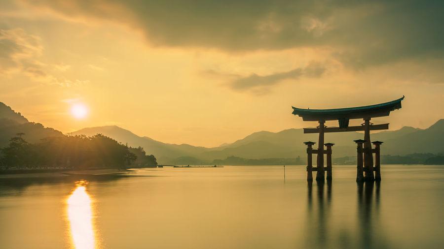 Hiroshima -Miyajima Itsukushima Shrine Japan Japan Photography Miyajima Architecture Beauty In Nature Built Structure Cloud - Sky Long Exposure Mountain Nature No People Outdoors Reflection Scenics Silhouette Sunset Tranquil Scene Tranquility Tree Water Waterfront