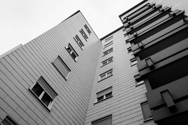 Urban Perspectives Black & White Street Photography Black And White Architectural Feature Balcony The Devil's In The Detail Streetphoto_bw Building Exterior Architecture Built Structure Low Angle View Building Sky City No People Clear Sky Nature Day Window Residential District Tall - High Apartment Modern Tilt Skyscraper The Architect - 2019 EyeEm Awards My Best Photo