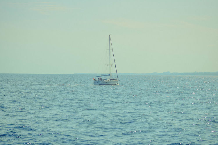 Sea Water Nautical Vessel Waterfront Sailboat Transportation Sailing Sky Mode Of Transportation Scenics - Nature Horizon Beauty In Nature Horizon Over Water Tranquility Day Tranquil Scene Nature Mast Non-urban Scene Outdoors Copy Space