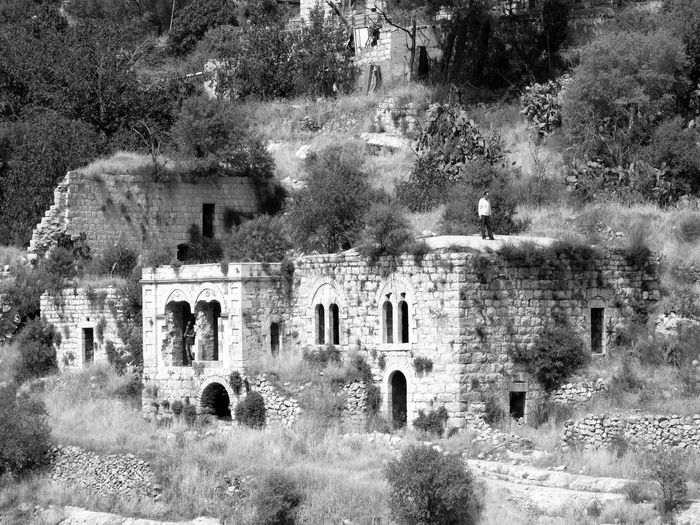 Lifta was a Palestinian Arab village on the outskirts of Jerusalem. The village was depopulated during the early part of the 1947–48 Civil War in Mandatory Palestine. During the war it housed Jewish refugees, and after the war was settled by Jewish families, who subsequently mostly left in 1969-71, following which parts of the village were used as drug rehabilitation clinic and a high school. It is located on a hillside between the western entrance to Jerusalem and the Romema neighbourhood. In 2012, plans to rebuild the village as an upscale neighborhood were rejected by the Jerusalem District Court. In 2017 the last Jewish residents left Lifta, and the village area was declared an Israeli nature reserve. Old Ancient Abandoned History The Past Built Structure Architecture Bnw_friday_eyeemchallenge Bnw_lostplaces