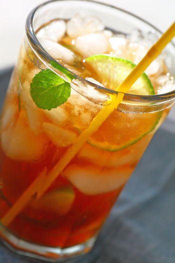 Sweet tea with crushed ice Beverage Citrus  Close-up Cold Drink Crushed Ice Day Drinking Glass Drinking Straw Freshness Hydrating Iced Tea Icy Indoors  Lime Mint Leaf - Culinary Natural Light No People Nonalcoholic Refreshment Studio Shot Summer Textures Thirst Quenching Wet