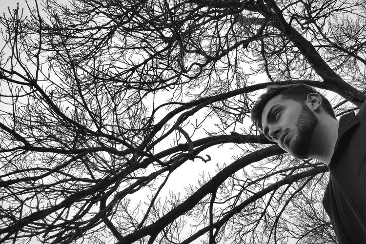 One Person Tree Low Angle View One Man Only Outdoors Day People Young Adult Adults Only Light And Shadows WeekOnEyeEm PortraitPhotography Portraitist - 2016 Eyeem Awards Adult Real People Chance Encounters Snap a Stranger Self Reflecting Thoughts Bnw Portrait Bnw Black And White Photography Black & White Lost In The Woods Lost In Thought Lost In Thought... The Portraitist - 2017 EyeEm Awards