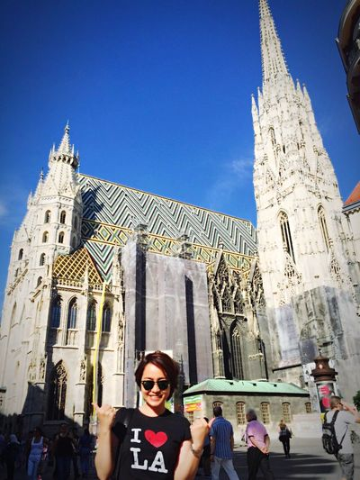 Portrait of happy young woman in front of st stephens cathedral