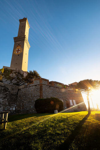 La Lanterna Sky Architecture Built Structure Building Exterior Plant Nature Sunlight Building Grass Tower History The Past Tree Clear Sky Lighthouse Lanterna Lanterna Di Genova Sunny Rays Rays Of Light Liguria Italy Genova Genoa Travel Destinations