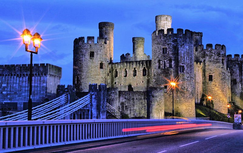 Conwy Castle at night, Wales Conwy Castle Architecture Building Building Exterior Built Structure City Cityscape Illuminated Light Trail Lighting Equipment Long Exposure Motion Nature Night No People Office Building Exterior Outdoors Railing Road Sky Skyscraper Street Street Light Transportation Travel Destinations