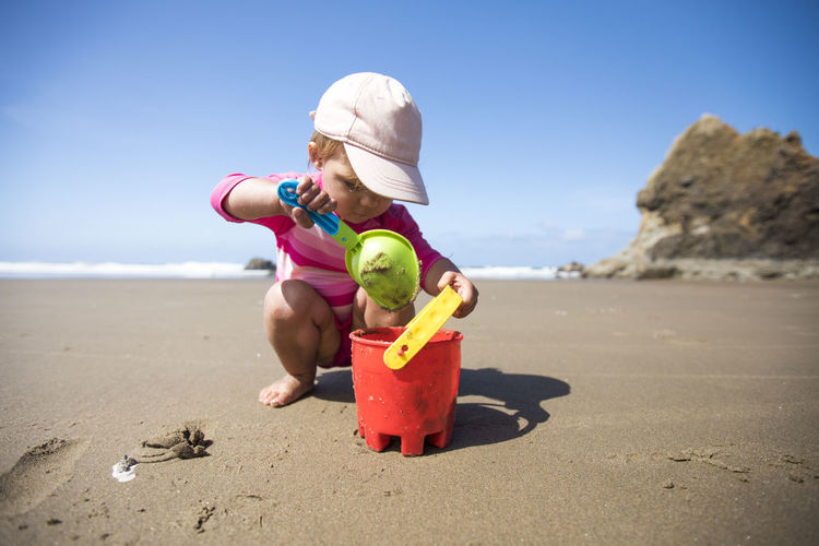 Full length of woman with toy on beach