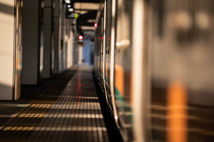 Architecture Indoors  No People Selective Focus Direction The Way Forward Defocused Illuminated Diminishing Perspective Corridor Rail Transportation Flooring In A Row Public Transportation Arcade Transportation Built Structure Food And Drink City Tiled Floor