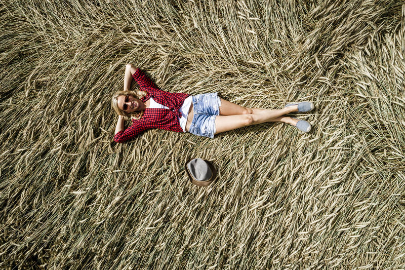 Portrait of woman lying on hay