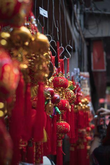 Red lanterns hanging for sale in market