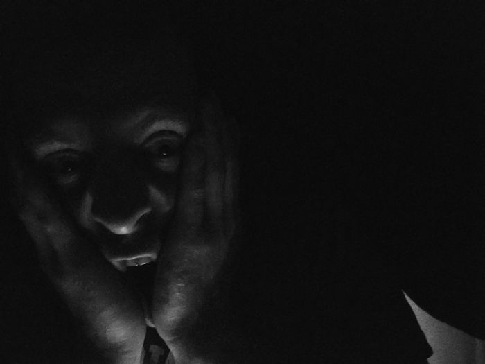 Portrait Emotions Horror Photography Fear Of The Dark Black And White Face Expression Man Face Mobile Photography In Shadow Grimace Mood Eyes Creativity Art Portrait  Art Monochrome Noise Perspective Dark Black Background Halloween Portrait Looking At Camera Spooky Horror Terrified Fear