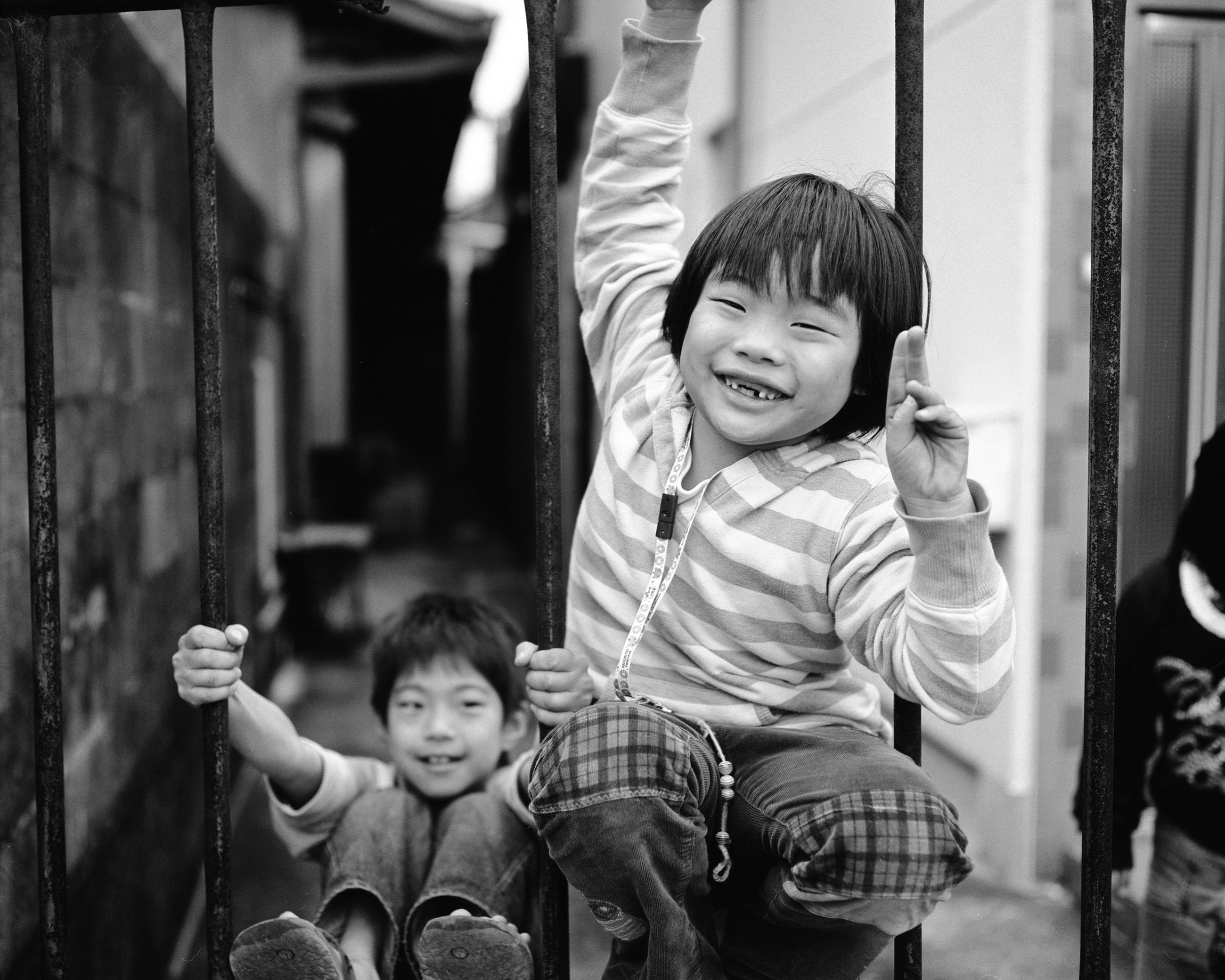 child, boys, childhood, males, two people, playground, smiling, people, outdoors, real people, portrait, cheerful, togetherness, day, adult