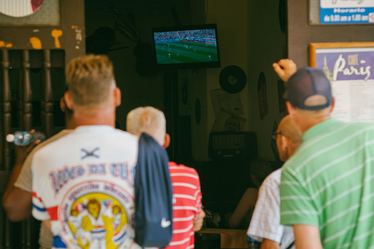 We watched the Worldcup in Cuba~ Adult Casual Clothing Communication Computer Focus On Foreground Group Of People Indoors  Lifestyles Love The Game Males  Men People Real People Rear View Standing Table Technology Text Waist Up Western Script Women
