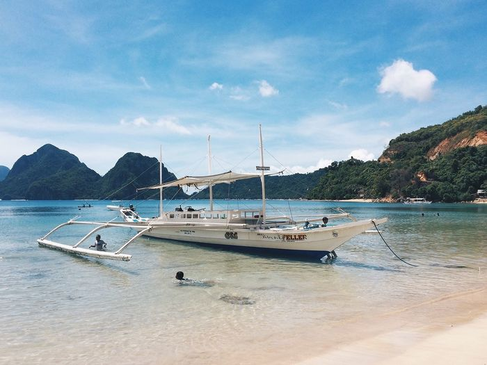 El Nido Philippines Nautical Vessel Water Transportation Mode Of Transportation Sky Sea Moored Beach Mountain Cloud - Sky Nature Beauty In Nature Sailboat Day Land No People Tree Scenics - Nature Travel