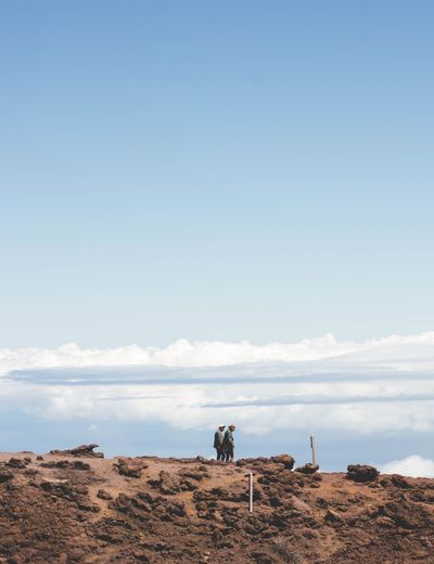 People standing on desert against sky