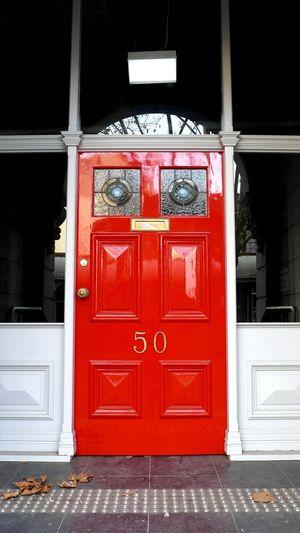 Bright red door Door Red No People Outdoors Architecture Built Structure Day Red Door No. 50 Office Office Door